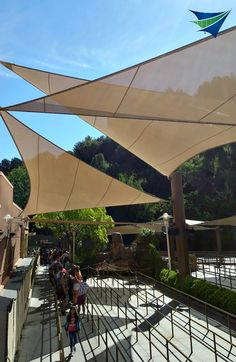 Shade sails for attraction lines protect patrons @tensileinc.com