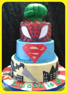 Superhero inspired cake! 3 tiers of French Vanilla and top done with RKT