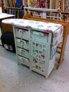 A cute little storage unit with an ironing board on top. I saw a dresser that would have been perfect for this but I let it slip away. & Ironing Board Cover with Pocket Storage | Ironing board covers ...