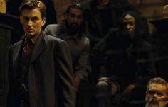 """Looking fancy in his fancy flashback suit, the Doctor tries to escape. 