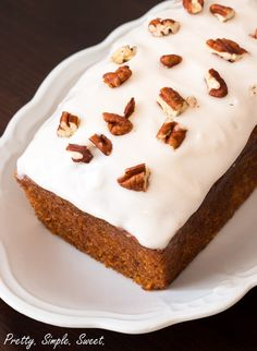 Easy recipe for a moist carrot cake loaf, topped with a sweet and tangy classic cream cheese frosting.