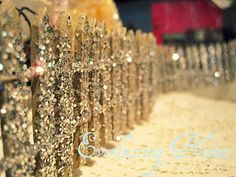 DIY miniature glitter fencing . . . This could be fun for the Christmas villages.  Use white flock for imitation snow!