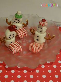 snowmen sledding made with candy canes, marshmallows, pretzels, life savers, mms