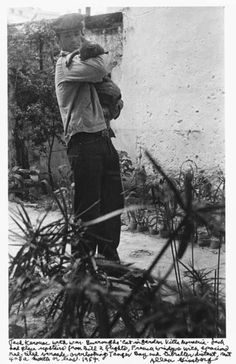 Jack Kerouac with William Burrough's cat. Tangier, Morocco, 1957.