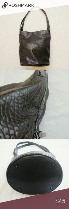 """French Connection large bucket bag Large croc texture bucket bag by French Connection. The color is a dark grey-ish brown. Carried once! Dark metal hardware, side zipper, protective feet on bottom, double shoulder straps. This will hold the kitchen sink. 13.5"""" w x 14"""" h x 10"""" diameter on bottom. 11"""" strap drop. French Connection Bags Shoulder Bags"""