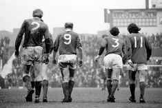 Manchester United's Bobby Charlton (9) and George Best (11) trudge back to the centre circle in unison after conceding a goal against Ipswich, 1971