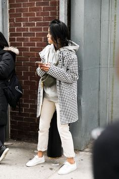 Le Fashion Blog New York Fashion Week Street Style Houndstooth Coat Grey Hoodie Off White Cuffed Jeans White Sneakers Via Collage Vintage