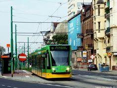 Poznań, tramwaj Siemens Combino #511 zjeżdża z nowego zielonego torowiska na ul.Głogowskiej. - #Poznan, #tramwaj, #tram Ul, Light Rail, Homeland, Trains, Around The Worlds, Street View, Cars, Autos, Car