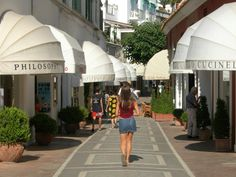 The most fashionable shopping street on an Island…Via Camerelle, Capri Island - Italy.  Luxuriant, romantic and with a mild weather: this is Capri, in addition to exclusive hotels and the yachts docked in the harbor. Celebrities and wealthy personalities have come here. Going shopping in Capri is perfect for those who are looking for the latest designer garment.