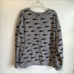 F21 Shark Sweater The sharks are a tiny bit faded due to washing, but the inside is still very soft. Let me know if you have any questions!  Forever 21 Sweaters Crew & Scoop Necks