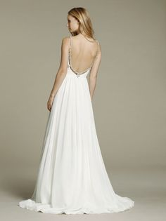 Ivory chiffon A-line bridal gown, draped bodice with curved V-neckline, beaded straps continued to low scoop back, full gathered chiffon skirt.