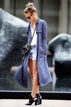 Denim shorts worn with a white button up and a duster jacket