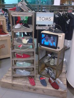 display of Toms shoes: but stacking crates could work for other things too.  AND if I made my own, they would all fit inside each other and be easy to carry in and out of shows.....