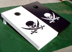 pirate corn hole game     - Make these with either a drinking game or a Motortrain logo on each.