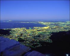 Cape Town, Western Cape: panoramic view of the city and Table Bay at night, seen from the top of Table Mountain. Photo by Walter Knirr. Copyright South African Tourism #travel