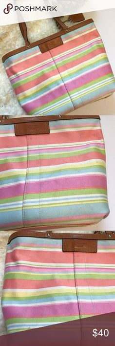 Multi color Striped Coach Purse! I used condition but structurally still solid! Material needs cleaned but the leather is in 👍🏻 condition! Only flaws in leather is shown in last pic, like this on each handle near seam of purse....Pictures show the spots on the material. All just from everyday use and wear. I think they could more than likely come out when spot treated! Has a clasp to hold purse closed. Features zipper pocket and two smaller pockets on the inside. Measurements to be posted…