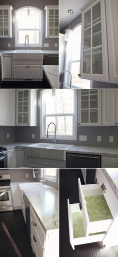 white cabinets, arched window, green shelf paper, drawer pulls