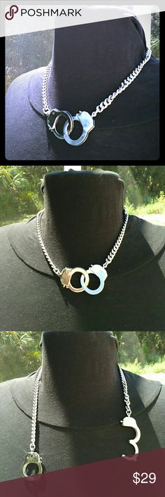 free handcuff keychain silver with necklace PRICE IS FIRM NO TRADES  Choker style necklace and free key chain Sherri Souza Boutique & Jewelry Jewelry Necklaces