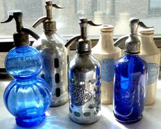 Personal collection of vintage soda siphon bottles and ceramic beer jugs from Argentina