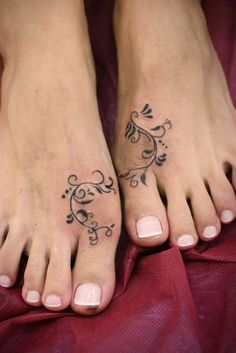 Interesting simple painted foot tattoo