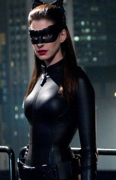 "Anne Hathaway as Selina Kyle. I like the costume, but at the same time she looks a little too much like ""Cat-girl"" rather than Catwoman."