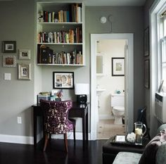Love this small little desk that fits in this nook in the wall - perfect size and the decor on it and the chair make it feel rich, comfy, and inviting.