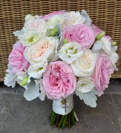 David Austin pink and ivory O'Hara Roses, white Lissianthus and Dusty Miller create this divine bouquet.