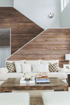 The living room and staircase behind the sofa- Eclectic Rustic Cottage Interior with Summer Beach Style Touches