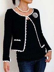Jasmine is a classic Chanel inspired jacket, with a slightly boxy form, fitted sleeves, and contrasting scallop trim around the edges. The placket opening of the sleeves is also trimmed