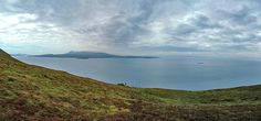 Cloudy Sound of Islay panorama from above McArthur's Head