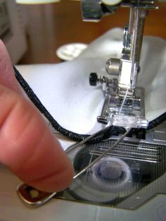 Good tip--using a safety pin to hold the end of the elastic that is being stretched and sewn down