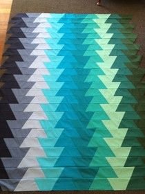 """Super fun """"Lightening Bolt Quilt"""" by Milly of Tin Whistle. (You can make this with a half hexie template!)"""