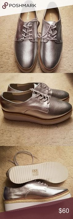 Silver Aldo Platform Shoes These classy Aldo Platform Shoes have never been worn. They simply are not my style and are a size bigger than me. They pair well with an all white outfit, black and silver, light or dark denim. But I'll let you be creative! Aldo Shoes Platforms