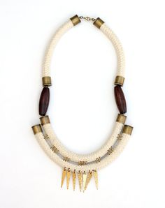 Oversized Tribal Rope Necklace with Hammered Brass Spikes. $54.00, via Etsy.