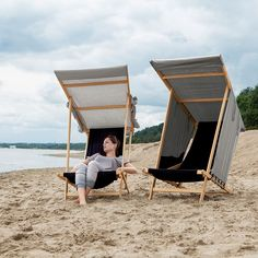 Designer beach chairs that let you pull down a piece of material from either side for a more private experience.