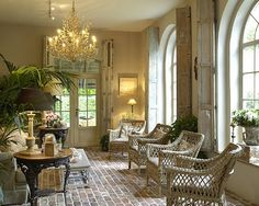 I am in LOVE with the brick floor, and the arch windows, and the chandelier!