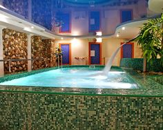 Photo about Sauna pool with waterfall and palms indoor. Image of comfortable, medicine, relax - 1894304 Amazing Architecture, Architecture Design, Sauna Room, Pool Waterfall, Luxury Spa, Luxury Hotels, Spa Design, Dream House Exterior, Hotel Spa