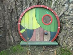 There are things you need, and then there are things you NEED. Apple Tree Fairy Door by BlueToucan (Etsy)