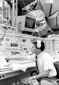 A NASA engineer works on the Lunar Mission Simulator
