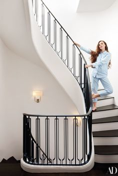 Diamond, in a Hill House Home pajama set, on the interior staircase of her home.