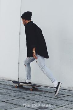 Men's street style, a black beanie with a black button-up shirt and light wash jeans with a pair of Vans   The Idle Man