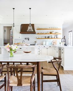 Do you love dreamy classic timeless rustic meets modern spaces like we do? Click through to see our collection of classic homes where rustic farmhouse meets chic + modern maison. Think crisp white walls and exposed timber beams. Think copper decor + hardware, worn wood floors, and plants. We think Joanna Gaines would approve of these dreamy kitchens, living rooms, bedrooms, bathrooms, and exteriors. #modernfarmhouse #rusticmodern