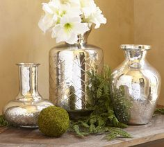 Kingsley Etched Mercury Glass Vases  http://www.potterybarn.com/products/kingsley-etched-mercury-glass-vases/?pkey=cchristmas-holiday-decor&cm_src=christmas-holiday-decor||NoFacet-_-NoFacet-_--_-
