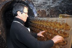 Riddling bottles of Cristal to move the yeast sediment down to the neck of the bottle