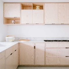 This light, bright and airy kitchen in plywood was custom designed by Made Architects. FOr more details see ELLE Decoration Kichens Volume 2. Link at end of post.