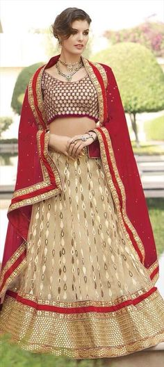 Machine Embroidery, Stone work and Patch work - check out this bridal #Lehenga with designer motifs.  #Wedding #bride #IndianWedding #OnlineShopping #Sale #Beige #Colorblock #india #partywear
