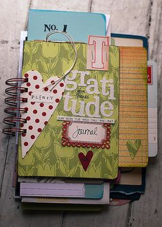 Gratitude journal using pages from odd and old notebooks
