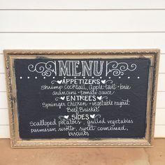 food vendor chalkboard display with menu -