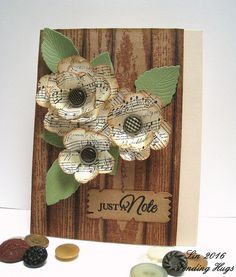 trio dimensional layered flowers from music paper . woodgrain backgrund on kraft . seet card by Lin of Sending Hugs . Sheet Music Crafts, Music Paper, Flower Cards, Paper Flowers, Fabric Flowers, Sending Hugs, Cricut Cards, Perfume, Cute Cards
