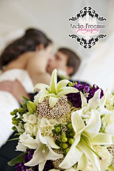Bride and groom portrait with bridal bouquet featuring white lilies and dark purple flowers. Classic fall wedding.  Photography by Andie Freeman Photography www.TheAthensWeddingPhotographer.com Planning and Coordinating by Wildflower Event Services www.WildflowerEventServices.com Venue and Floral:  The Thompson House and Gardens, Athens, GA